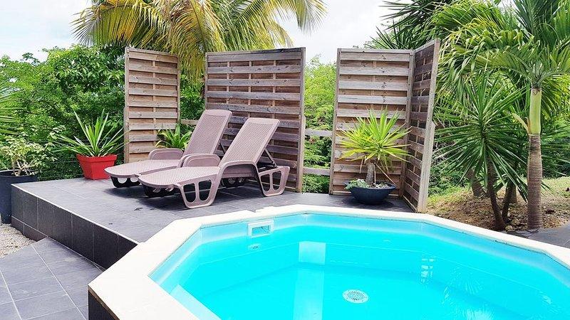 REZ DE JARDIN 2/3 PERSONNES AVEC PISCINE PRIVATIVE - situé à 1k5m des plages, casa vacanza a Marie-Galante