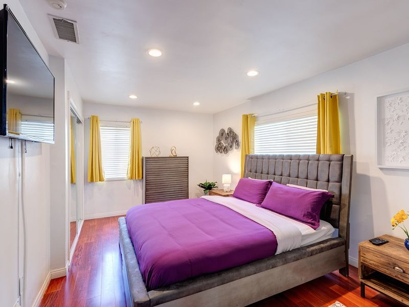 Beautiful master bedroom with king-sized bed, top of the line bedding and linens, smart TV loaded with Netflix etc