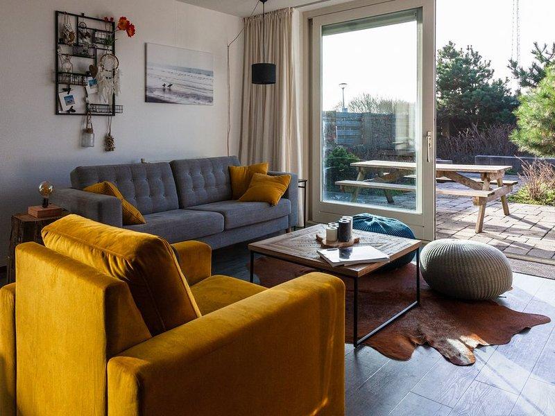 Gezellig ruim appartement met eigen tuin aan de voet van de duinen., aluguéis de temporada em Groote Keeten