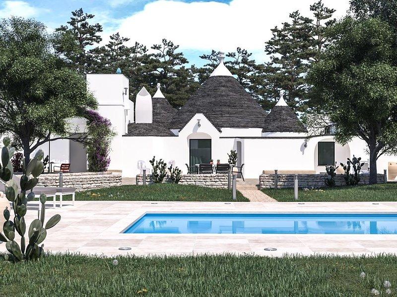 NOUVEAU : Trullo traditionnel avec piscine privée et jacuzzi + oliveraie, holiday rental in Villa Castelli