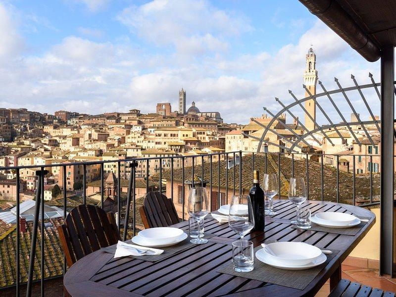 Central panoramic apartment San Martino!, aluguéis de temporada em Siena