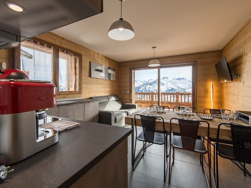 Appartement traversant sur les pistes, aluguéis de temporada em Fontcouverte-la-Toussuire