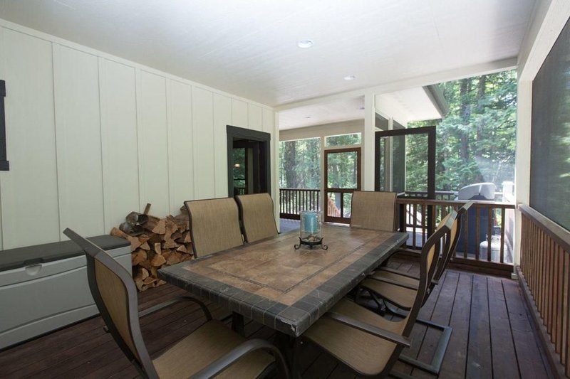 Main level, outdoor screened in porch with seating for 8.