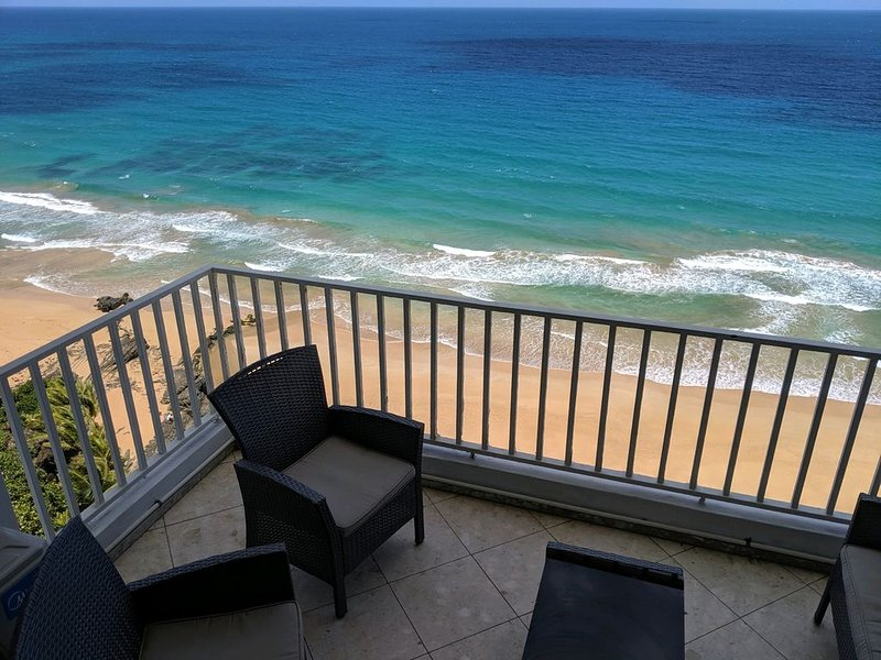 Oceanfront, Hear waves 24/7, 2 bedroom condo w full kitchen, Prime location, holiday rental in Luquillo