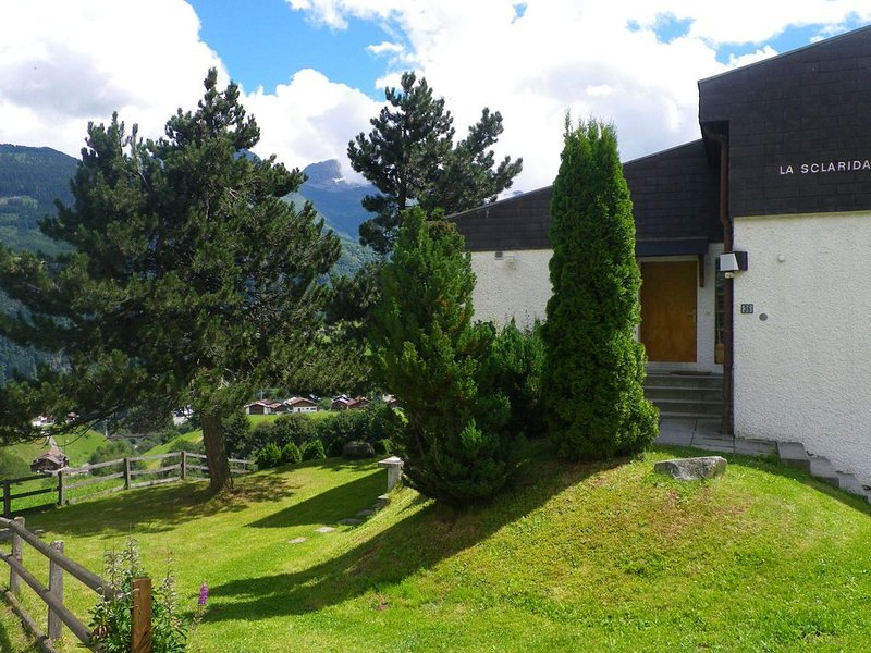 Apartment in Disentis with Garden, BBQ & Mountain Views, holiday rental in Segnas