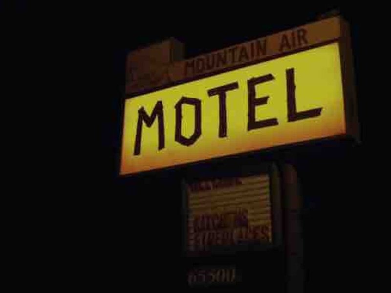 The Original Mountain Motel Sign - still in use 60+ years later - it looks orange by day and sometimes will light up at night but it's glitchy and old.
