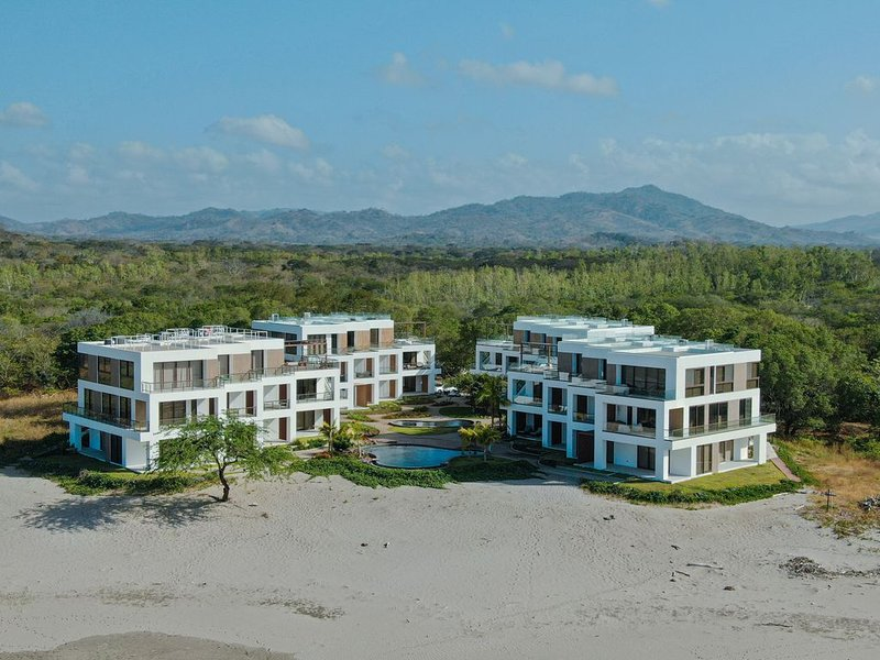 VILLA CORONADO: Brand new, exquisitely decorated two story beach front condo., vacation rental in Tola