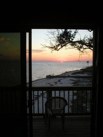 Zonsondergang met uitzicht op de Golf van Mexico
