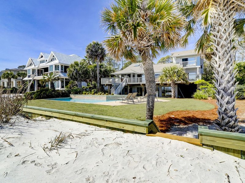 about 20 yards separates pool and sand dune/beach