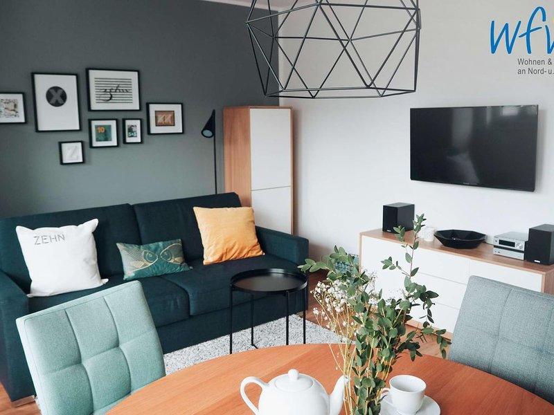 Komfortable Ferienwohnung mit sonnigem Balkon und Garten für 100% Entspannung!, location de vacances à Borkum