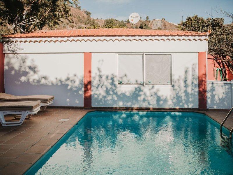 Casa rural con piscina en Hoya de Tunte 4, aluguéis de temporada em Fataga