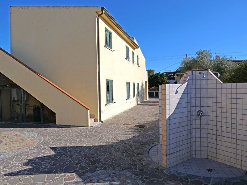 Appartemento 150mt dalla spiaggia Porto Ottiolu con ampio giardino, holiday rental in Ottiolu