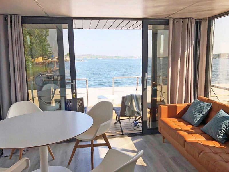 Urlaub auf dem Hausboot Fjord Lacerta in Wendtorf mit Dachterrasse und W-LAN, holiday rental in Wendtorf