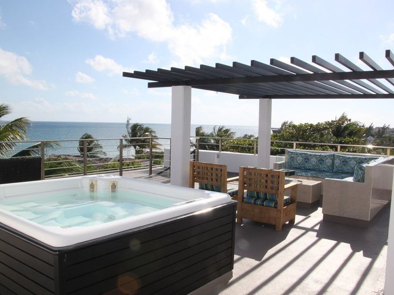 ocean front penthouse condo with private rooftop terrace in Palma Real, holiday rental in Puerto Morelos