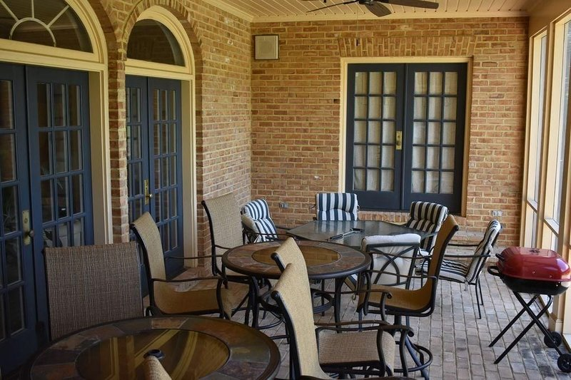 Screen porch with gas grill and fire table. We provide the propane. Ponds