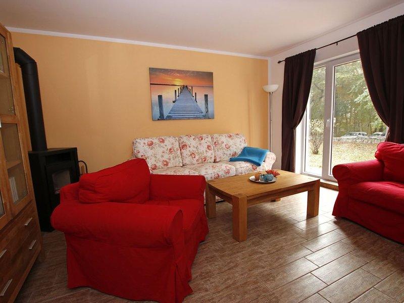 Blaues Ferienhaus in Karnin - kleine Ferienwohnung, location de vacances à Friedland
