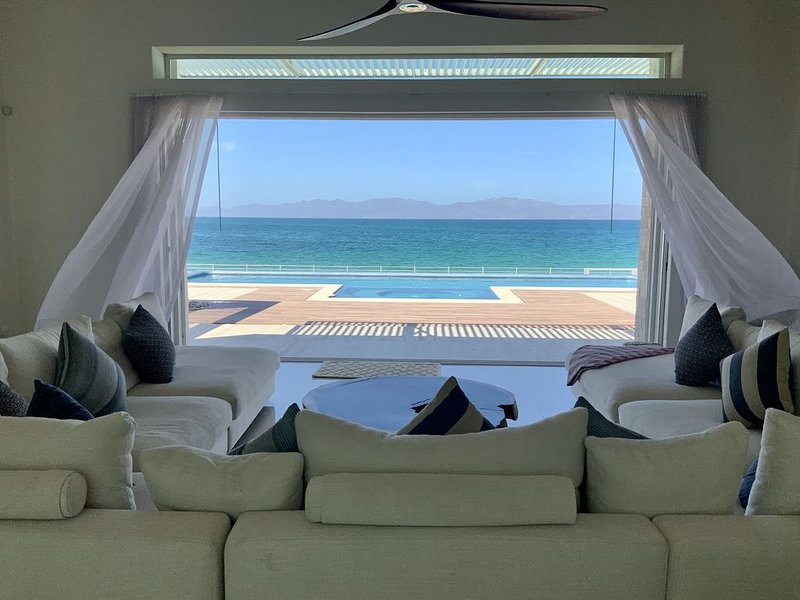 Modern beachfront house with pool, holiday rental in El Sargento