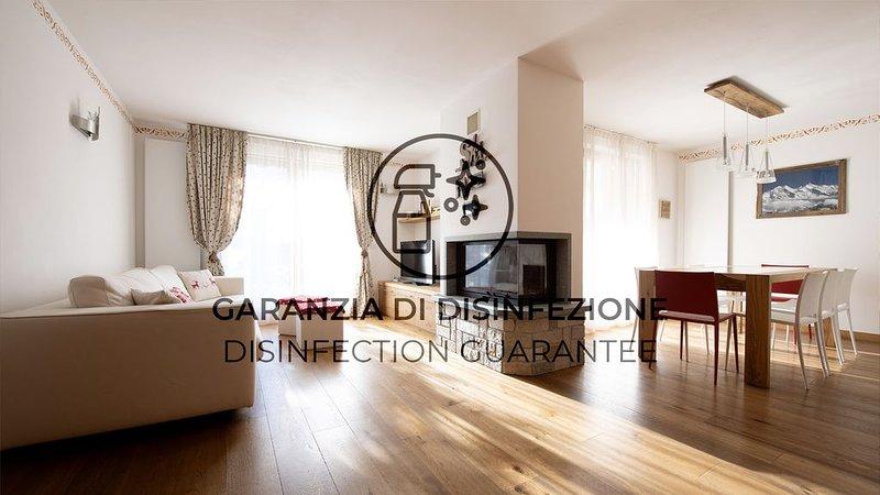 Luminoso e confortevole appartamento con Wi-Fi e giardino, location de vacances à Valdisotto