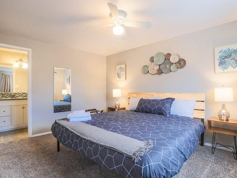 The upstairs master bedroom features a plush King bed and attached bathroom