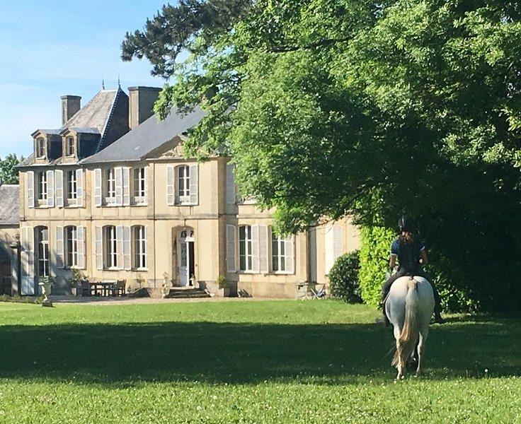Dépendance du chateau, aluguéis de temporada em Port-en-Bessin-Huppain