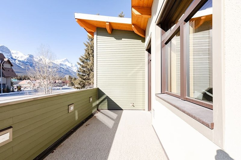 Large deck with views all the way to Banff. BBQ and outdoor seating will be installed before summer