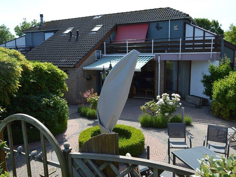 Octalet: Rustig gelegen, mooie tuin, op het eiland met de meeste zonuren!, holiday rental in Brouwershaven