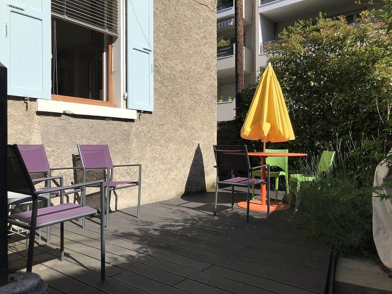 Agréable 3 pièces avec jardinet et parking proche du centre, location de vacances à Tresserve
