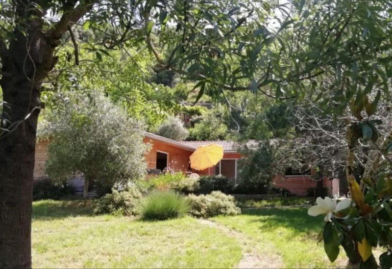 Maison d'architecte - terrasse et jardin arboré, location de vacances à Le Bousquet d'Orb