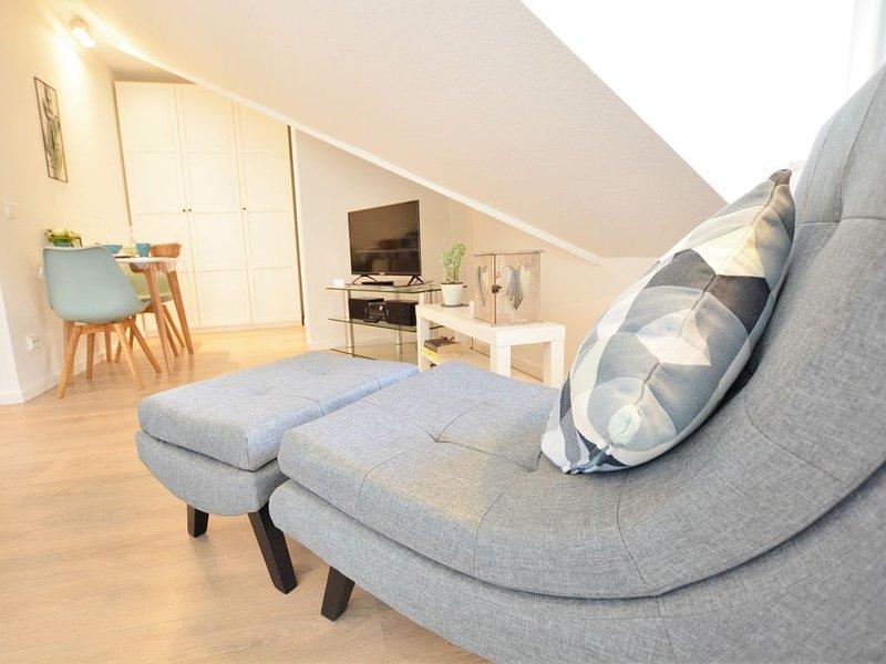 Stilvoll renoviertes 1-Zimmer-Appartement - Balkon, WLAN, TV, innenstadtnah, Ferienwohnung in Grolsheim