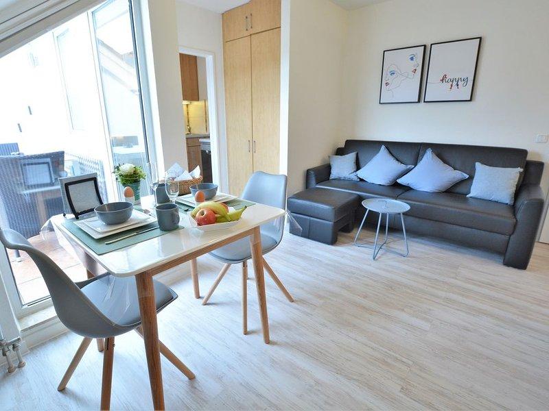 Stilvoll renoviertes 1-Zimmer-Appartement - Balkon, Aufzug, TV, WLAN, Ferienwohnung in Grolsheim
