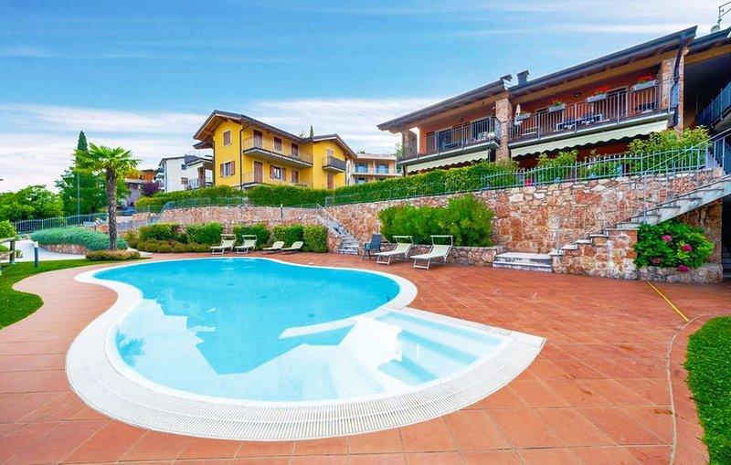 Residence con Piscina tra Lago e Montagna, casa vacanza a Pai