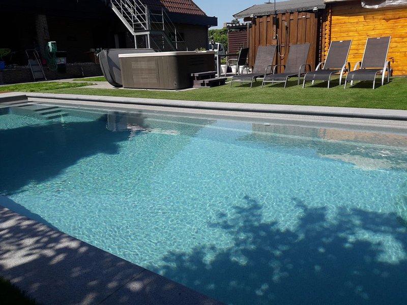 Appartement met zwembad jacuzzi 3 slaapkamers, aluguéis de temporada em Heusden-Zolder