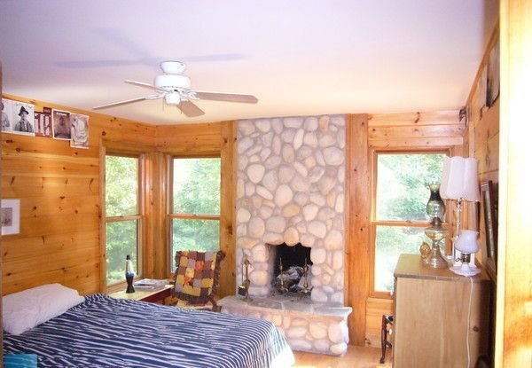 Bedroom with a wood burning fireplace