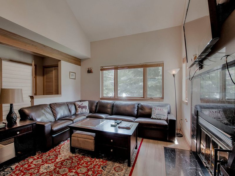 Cozy living room with wood burning fireplace, DVD player & TV
