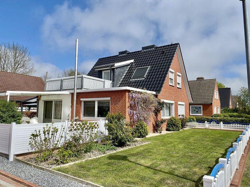 Ferienwohnung, ebenerdig, WLAN, überdachte Terrasse, Kaminofen, location de vacances à Krummhoern