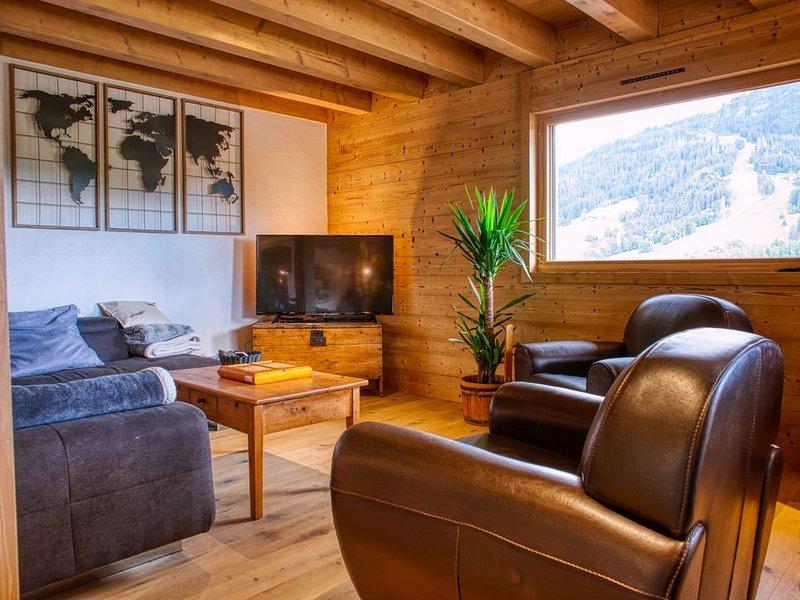 Chalet bois, plein sud , face aux pistes de ski, location de vacances à Praz Sur Arly