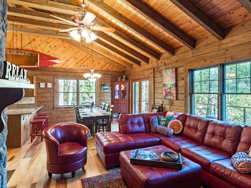 Large living room area with vaulted ceilings.