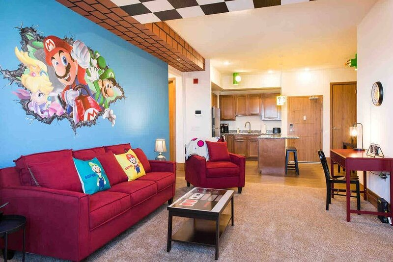 Open floor plan with bright, Mario themed decor
