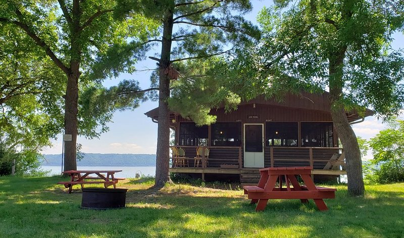 Camp Pepin's JJ Saul Cabin - Fall asleep to the Rippling Waters of Lake Pepin, holiday rental in Lake City