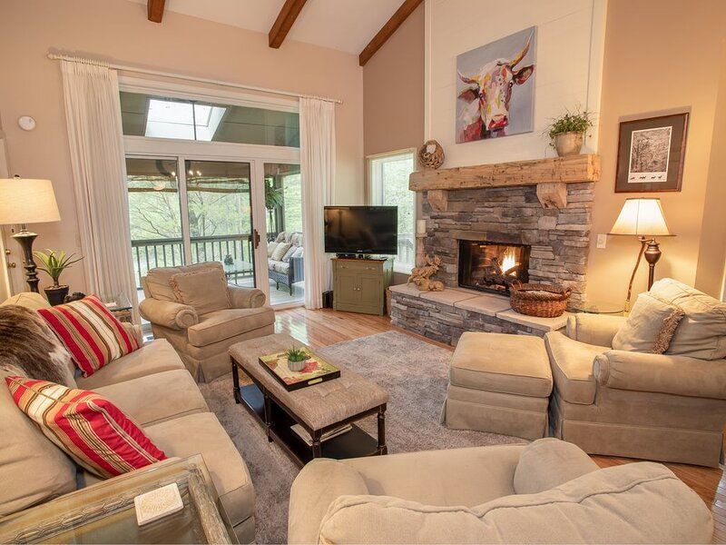 Holy Cow Great Room with Vaulted Ceilings, Exposed Beams, Stone Fireplace, and HD Smart TV