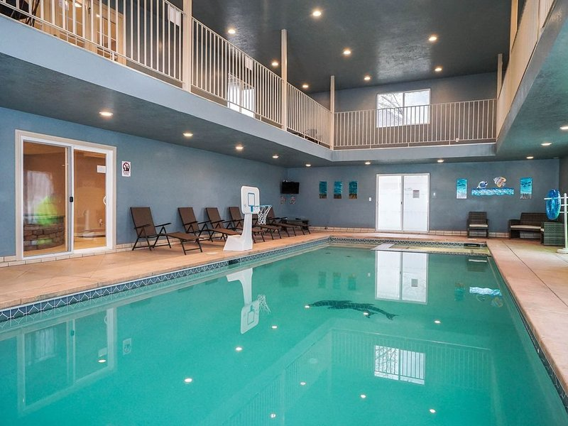 Awesome indoor pool with basketball provided for fun pool ball