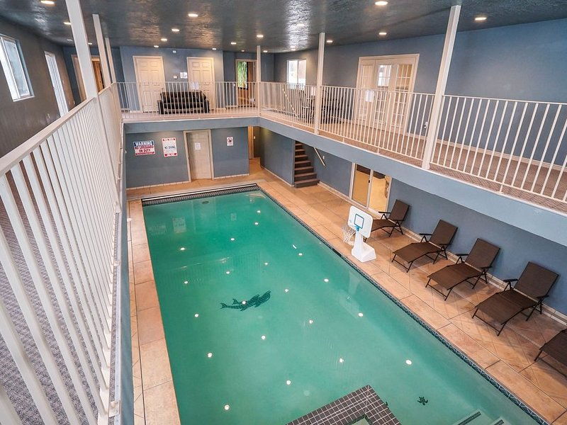 Upper main floor balcony overlooks lower pool