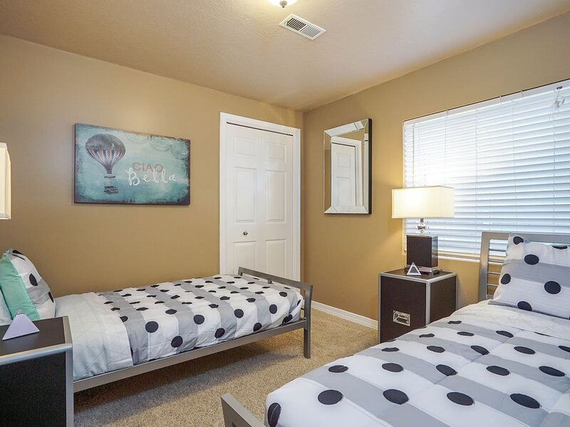 Bedroom 7 in basement with 2 twin beds