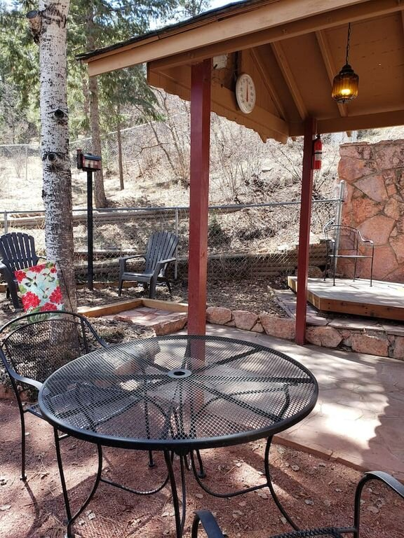 The back yard and patio area is perfect for enjoying cool mountain nights.