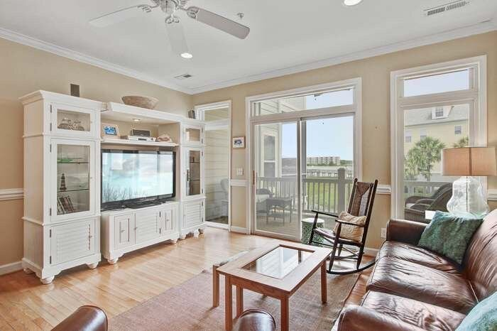Living room  with sliding doors to screened porch