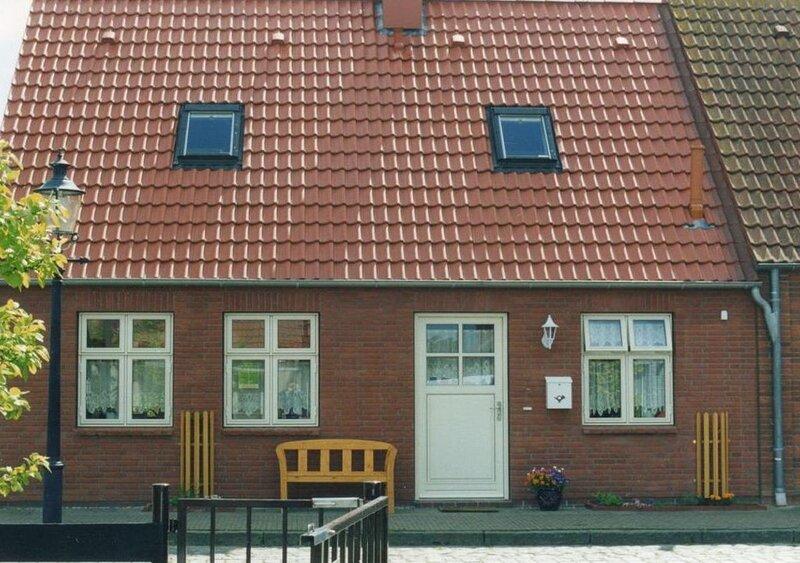 Ruhiges Ferienhaus in Friedrichstadt mit sonniger Südterrasse, Garten und Hof, casa vacanza a Husum
