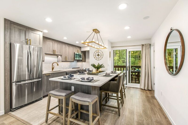 Designer kitchen with island dining that seats up to 7. The well-stocked kitchen will allow you to prepare meals with ease.