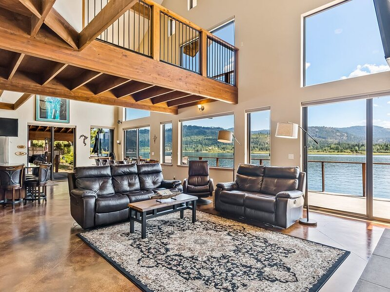 Custom-built riverfront home w/ private dock, game room, hot tub, heated floors!, vacation rental in Newport
