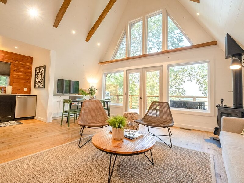 Massive windows fill the open concept living area and kitchen