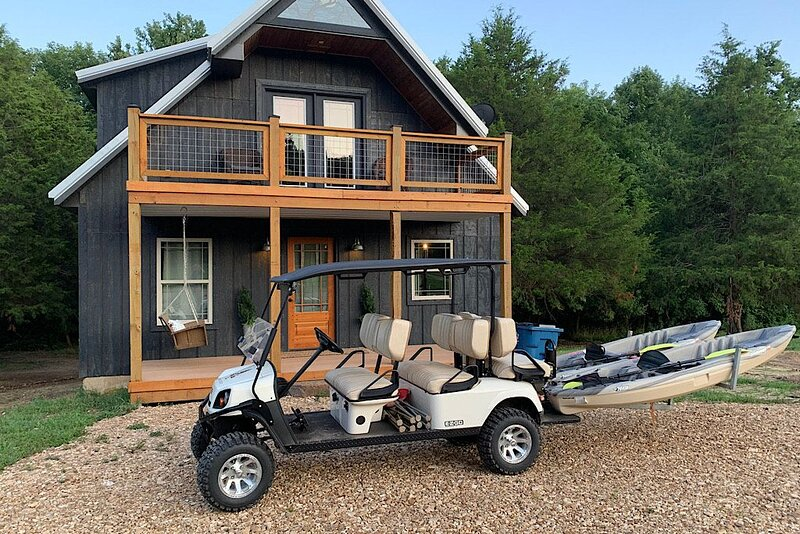 Secluded, idyllic cabin on 25 river front acres/utv and kayaks included, vacation rental in Nixa